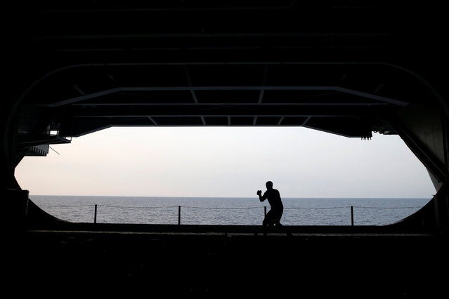 A US Navy sailor exercises in the hangar of the USS Harry S. Truman aircraft carrier in the eastern Mediterranean Sea, June 14, 2016. (Photo by Baz Ratner/Reuters)