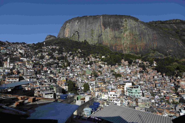 """A general view of the Rocinha favela, one of the slums that was included in the """"police pacification unit"""" program that began in 2008, in Rio de Janeiro, Brazil, July 24, 2016. (Photo by Bruno Kelly/Reuters)"""