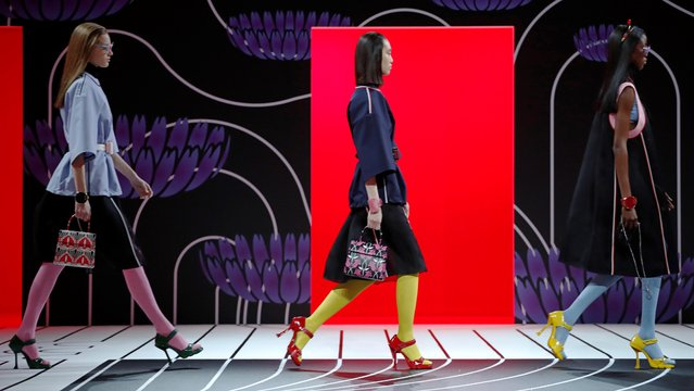 Models present creations from the Prada Autumn/Winter 2020 women collection during Milan Fashion Week in Milan, Italy, February 20, 2020. (Photo by Alessandro Garofalo/Reuters)