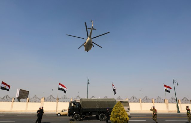 A helicopter carrying the coffin of former Egyptian President Hosni Mubarak flies during his funeral east of Cairo, Egypt on February 26, 2020. (Photo by Amr Abdallah Dalsh/Reuters)