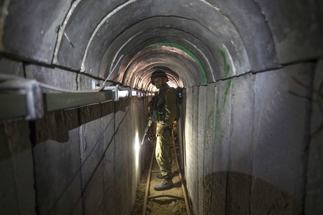 An Israeli army officer walks during an army organised tour for journalists in a tunnel said to be used by Palestinian militants for cross-border attacks, July 25, 2014. (Photo by Jack Guez/Reuters)