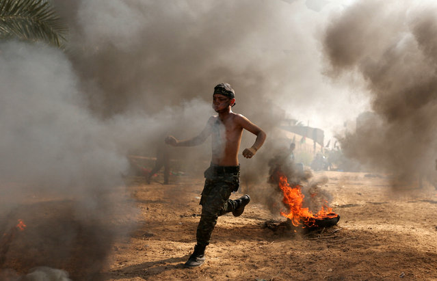 A young Palestinian takes part in a military-style exercise at a summer camp organised by the Islamic Jihad Movement in Khan Younis in the southern Gaza Strip July 13, 2016. (Photo by Ibraheem Abu Mustafa/Reuters)