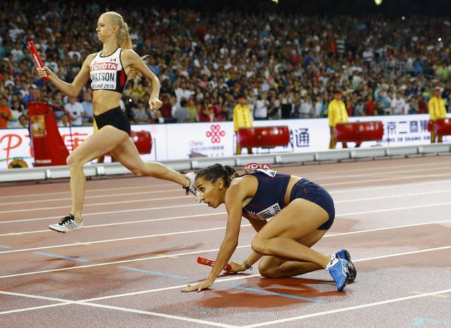 Agnes Raharolahy of France gets up after falling in the changeover area as she competes in the women's 4 x 400 metres relay final  during the 15th IAAF World Championships at the National Stadium in Beijing, China, August 30, 2015. (Photo by Kai Pfaffenbach/Reuters)