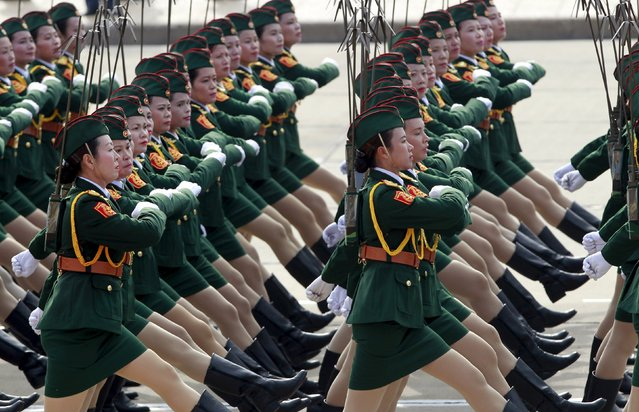 Vietnamese female commissioned officers of the signal force march during a parade marking their 70th National Day at Ba Dinh square in Hanoi, Vietnam September 2, 2015. (Photo by Reuters/Kham)