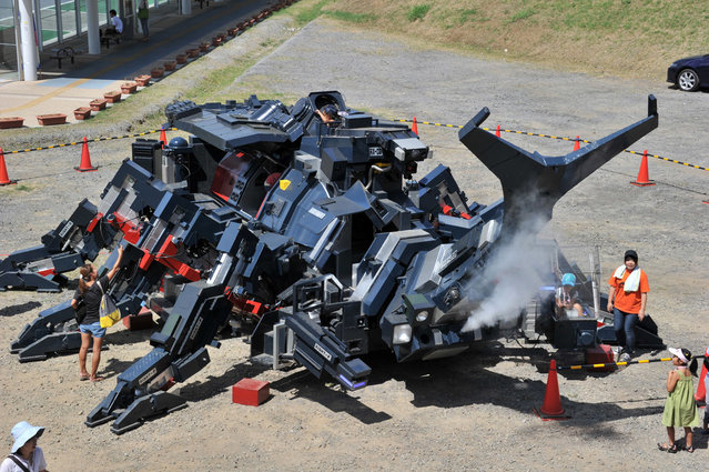 "A large beetle-shaped robot ""Kabutom RX-03"", produced by a Japanese engineer Hitoshi Takahashi is displayed before public at the Tsukuba Festival at Tsukuba city, Tokyo, on August 26, 2012. The Kabutom, 11-meters in length and weighing 17-tons, can walk with its six legs, powered by diesel engines and can blow smoke from its nose. (Photo by Yoshikazu Tsuno/AFP Photo)"