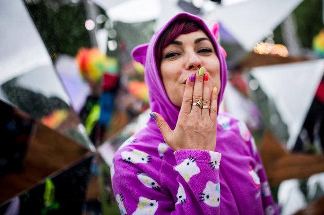 A festival-goer enjoy on Shipyard Island, the venue of the 24th Sziget (Island) Festival in Northern Budapest, Hungary, 10 August 2016. (Photo by Szabó Balázs/Rockstar Photographers)