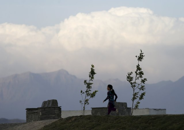 An Afghan girl walks as the sun sets in Kabul, Afghanistan, September 7, 2015. (Photo by Mohammad Ismail/Reuters)