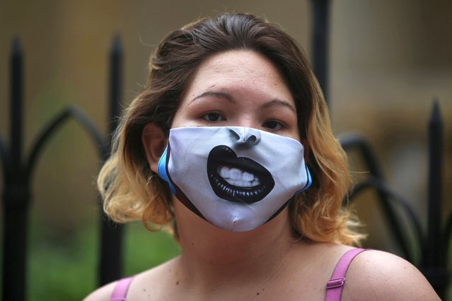A Venezuelan migrant wearing a face mask is seen standing in line to receive food aid donated by officials from the Bogota embassy of Venezuelan opposition leader Juan Guaido,  who many nations have recognised as the country's rightful interim ruler, amid the coronavirus disease (COVID-19) outbreak in Bogota, Colombia on May 29, 2020. (Photo by Luisa Gonzalez/Reuters)
