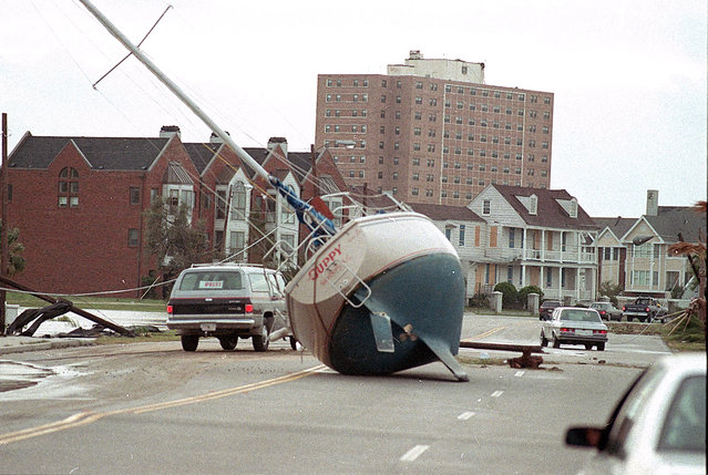 A sailboat lies in the street of Charleston on September 22, 1989 after it was washed ashore by Hurricane Hugo.  (Photo by Lou Krasky/AP Photo)