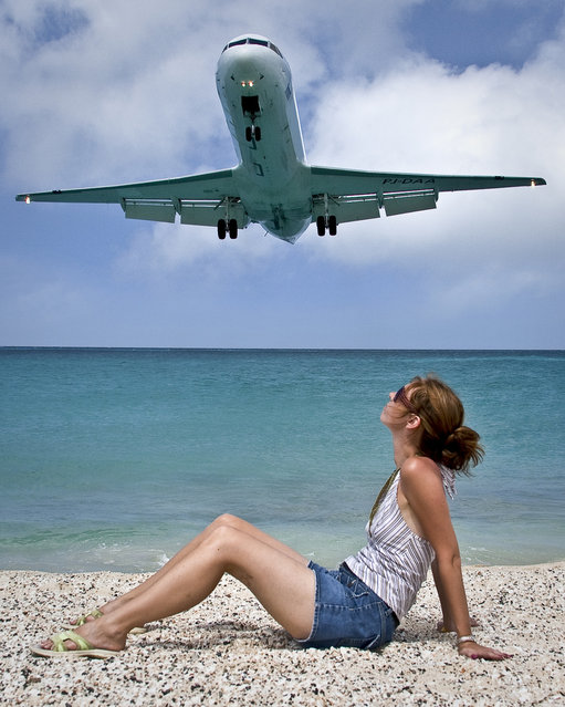 """""""Plane Landing over Maho Beach, St. Martin. From our trip to St. Maarten. Planes came in to land very low over this beach right next to our resort (Sonesta Maho), very cool"""". (Photo by R.G. Ewing)"""