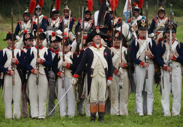 Participants in the military historical reconstruction of the Battle of Borodino during presentation in Borodino Field, Moscow Region on September 4, 2016. (Photo by Kirill Kallinikov/Sputnik)