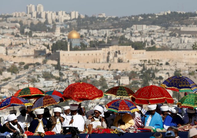 A general view shows the Dome of the Rock in the background as Kessim, religious leaders of the Israeli Ethiopian community take part in a ceremony marking the Ethiopian Jewish holiday of Sigd in Jerusalem on November 27, 2019. (Photo by Corinna Kern/Reuters)
