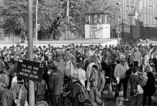 West Berlin citizens welcome East Germans who passed the border checkpoint Invalidenstrasse in Berlin, November 9, 1989. (Photo by Fabrizio Bensch/Reuters)