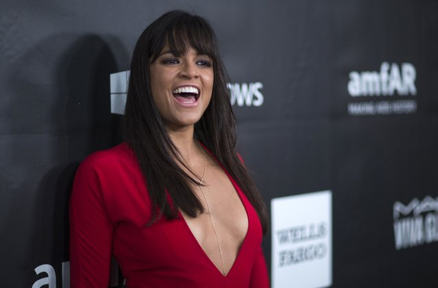 Actress Michelle Rodriguez poses at the amfAR's Fifth Annual Inspiration Gala in Los Angeles, California October 29, 2014. (Photo by Mario Anzuoni/Reuters)