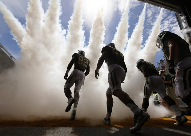 Baylor defensive tackle Micheal Johnson, left, leads teammates onto the field before an NCAA college football game against SMU, Saturday, September 10, 2016, in Waco, Texas. (Photo by L.M. Otero/AP Photo)