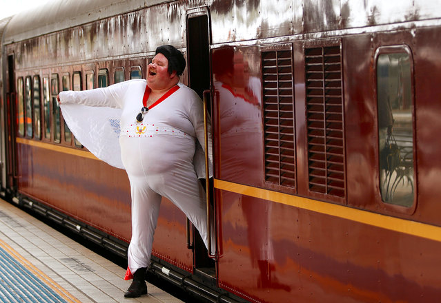 Elvis Presley impersonator Sean Wright poses next to the Elvis Express train at Sydney's Central station before it departs for the 26th annual Elvis Festival being held in the New South Wales town of Parkes in Australia, January 11, 2018. (Photo by Daniel Munoz/Reuters)