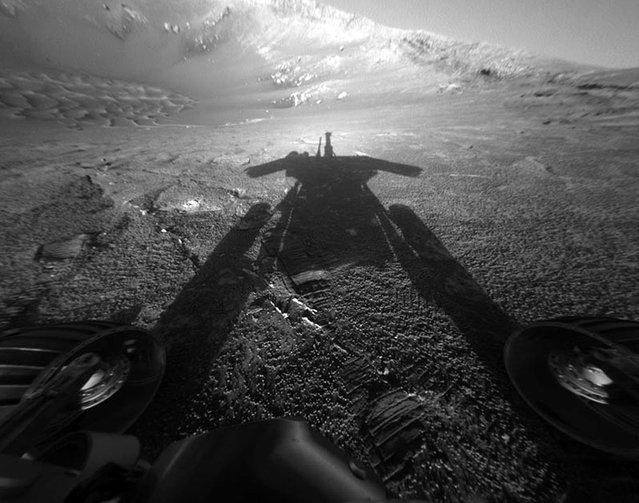A shadow cast by NASA's Mars Rover Opportunity stretches across the Martian surface in this image taken on July 26, 2004. (Photo by AP Photo/ NASA, JPL/The Atlantic)