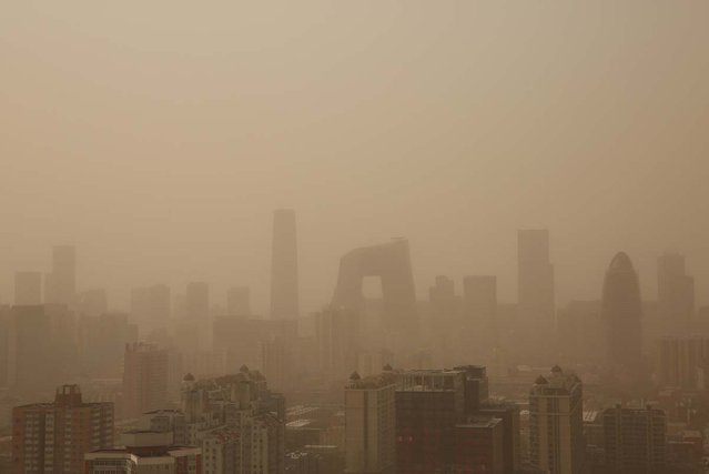 A general view of the skyscrapers in the sandstorm on February 28, 2013 in Beijing, China. Beijing was hit by its first sandstorm of the year while its air quality reached dangerous level on Thursday.  (Photo by Feng Li)
