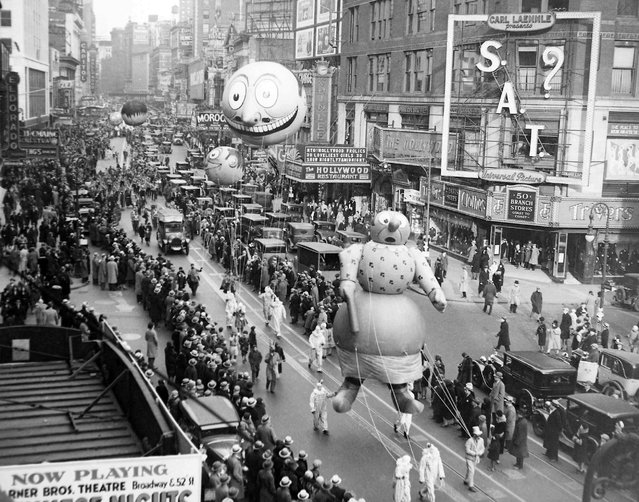 The Macy's Thanksgiving Day Parade passes down Broadway in New York on November 27, 1930.  The parade's first giant balloons debuted in 1927. (Photo by AP Photo/File)