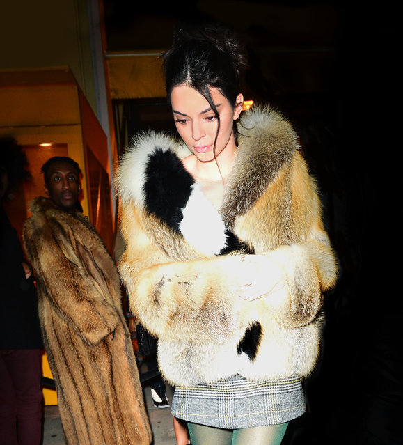 Kendall Jenner looks striking in a fur coat and plaid dress as she goes to party in NYC, USA on February 9, 2018. (Photo by Splash News and Pictures)