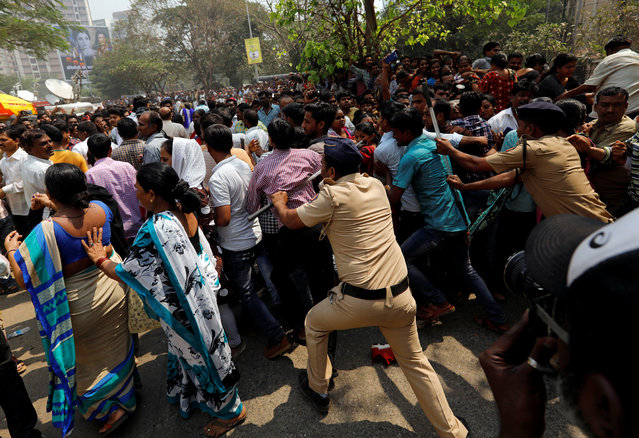 Fans of Bollywood actress Sridevi are pushed by policemen as they wait to offer condolences outside a makeshift memorial in Mumbai, February 28, 2018. (Photo by Danish Siddiqui/Reuters)