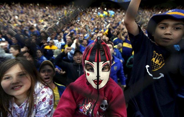 A Boca Juniors' fan wears a Halloween mask as she attends the Argentine First Division soccer match against Tigre in Buenos Aires, Argentina, November 1, 2015. (Photo by Marcos Brindicci/Reuters)