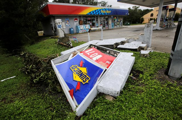 A sign of a Sunoco gas station, damaged by Hurricane Matthew, is seen in Melbourne, Florida, U.S. October 7, 2016. (Photo by Henry Romero/Reuters)