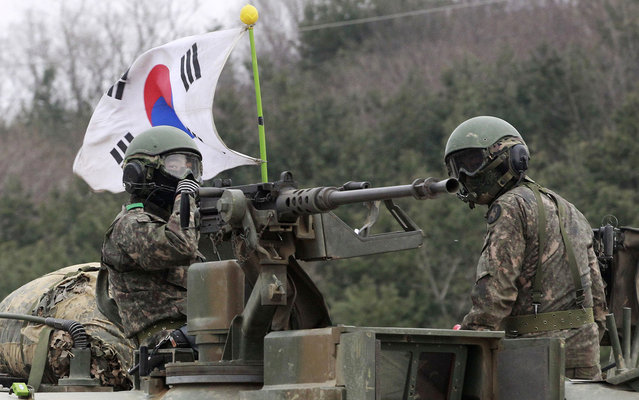 South Korean Army soldiers ride a K-1 tank during an annual military exercise in Paju near the border village of the Panmunjom, South Korea, Friday, April 19, 2013. North Korea on Thursday demanded the withdrawal of U.N. sanctions and the end of U.S.-South Korea military drills as conditions for resuming talks meant to defuse tension on the Korean Peninsula. (Photo by Ahn Young-joon/AP Photo)