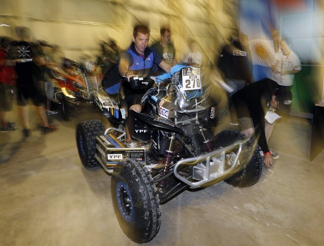 Argentina's Daniel Domaszewski riding his Honda quad arrives for technical verification ahead of the Dakar Rally 2015 in Buenos Aires January 1, 2015. (Photo by Enrique Marcarian/Reuters)