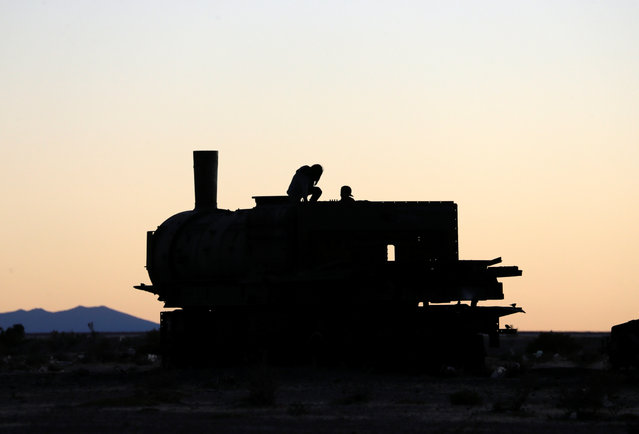 A silhouette of a locomotive of Bolivian Railways Company from 1870-1900 is seen at the train cemetery in Uyuni, Potosi, Bolivia on May 16, 2018. (Photo by David Mercado/Reuters)
