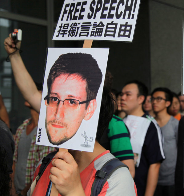 Hong Kong help: Supporters of Edward Snowden gather outside the Hong Kong government building Saturday. (Photo by Bloomberg)