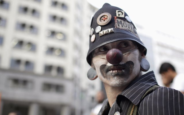 A demonstrator attends a protest against fare hikes for city buses in Rio de Janeiro January 16, 2015. Amid a marked economic downturn and high inflation, bus fares went up in Sao Paulo, Brazil's largest city, from 3 to 3.50 reais, and in Rio, the former capital, from 3.0 to 3.40 reais. (Photo by Mauro Pimentel/Reuters)