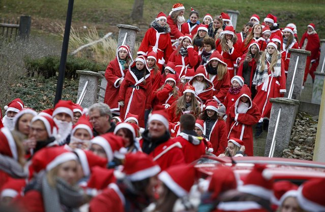 People dressed as Santa Claus take part in the 22nd Santa Claus meeting in Auerbach, Germany, December 6, 2015. (Photo by Michaela Rehle/Reuters)