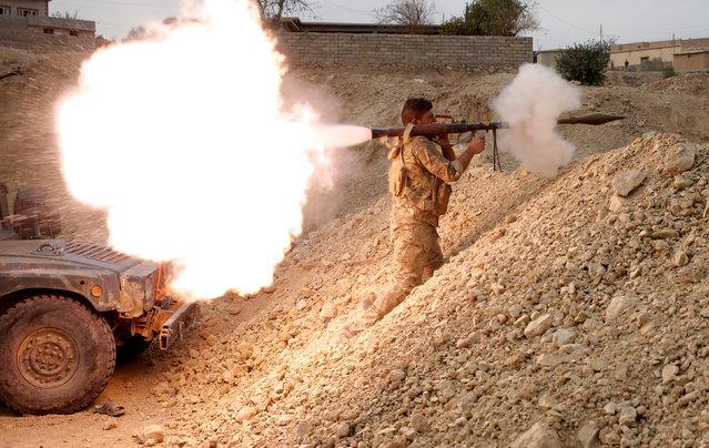An Iraqi soldier fires a RPG in Karamah, south of Mosul, Iraq November 10, 2016. (Photo by Goran Tomasevic/Reuters)