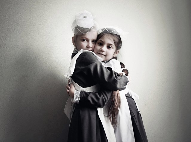 Two girls at a Kiev military school, where boys learn to fight and girls learn to become good brides. (Photo by Aude Osnowycz/The Sun)