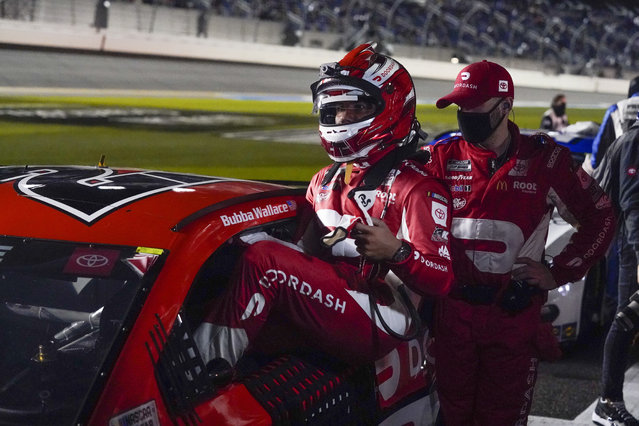 Bubba Wallace gets into his car after a weather delay during the NASCAR Daytona 500 auto race at Daytona International Speedway, Sunday, February 14, 2021, in Daytona Beach, Fla. (Photo by John Raoux/AP Photo)