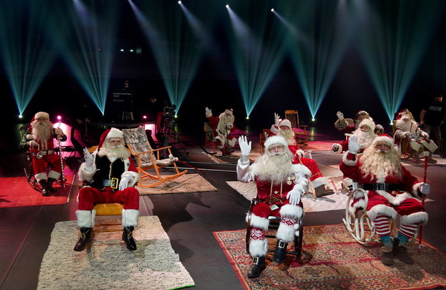 Santa Clauses wave in studio during online Global Santa Congress amid the coronavirus pandemic in Tallinn, Estonia on December 13, 2020. (Photo by Janis Laizans/Reuters)