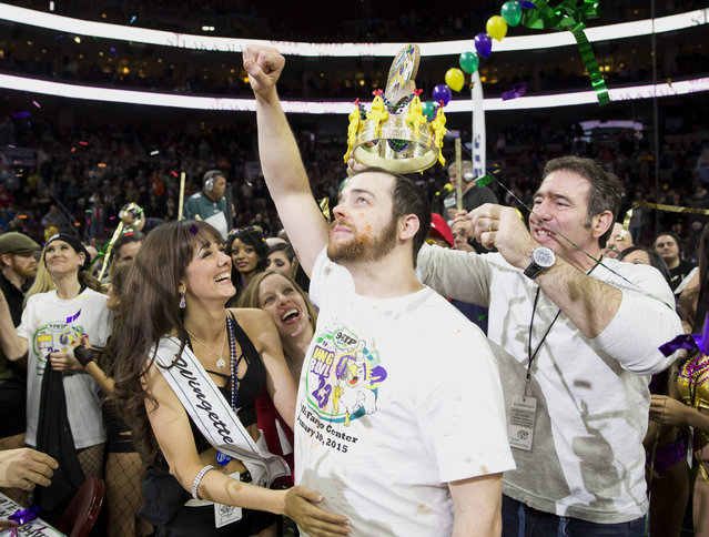 Patrick Bertoletti reacts after setting a new Wing Bowl record by eating 444 wings and wins Wing Bowl 23 on January 30, 2015 at the Wells Fargo Center in Philadelphia, Pennsylvania. (Photo by Mitchell Leff/Getty Images)
