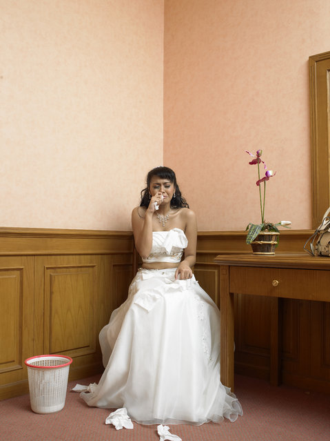 Bride crying in corner of room. (Photo by Hans Neleman/Getty Images)