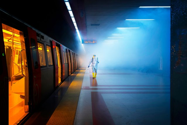 Category winner, open competition, street photography. Disinfection, a cinematic image documenting an employee of the health affairs unit of Ankara municipality in protective gear walking along the train platform while spraying it with disinfectant. (Photo by F. Dilek Uyar/Sony World Photography Awards)