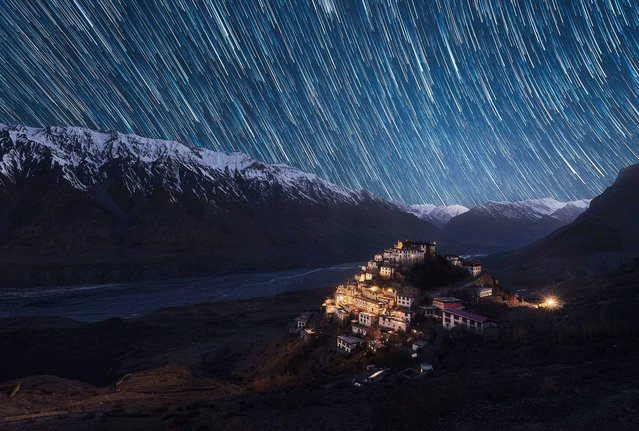 Key Monastery illuminated on a mountain side in the Spiti Valley, Himachal Pradesh, northern India with star trails pictured overhead. (Photo by Grey Chow/Caters News Agency)