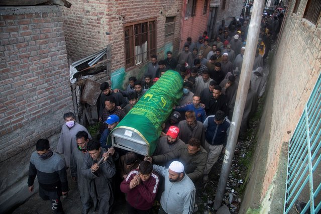 Kashmiri villagers carry the coffin of elected official Riyaz Ahmad in Sopore, 55 kilometers (34 miles) north of Srinagar, Indian controlled Kashmir, Monday, March. 29, 2021. (Photo by Mukhtar Khan/AP Photo)