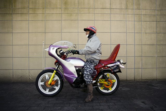A biker poses on his Bousouzoku motorbike at the Dangouzaka rest stop in Yamanashi, west of Tokyo, Japan, January 3, 2016. (Photo by Thomas Peter/Reuters)