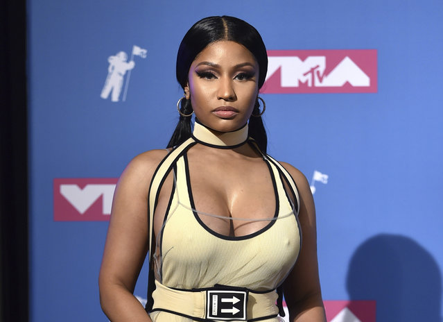 """In this August 20, 2018 file photo, Nicki Minaj poses in the press room at the MTV Video Music Awards in New York. Minaj has cancelled her North American tour with rapper Future. She said on her Twitter account Tuesday night that she didn't have enough time to rehearse for the upcoming """"NickiHndrxx"""" tour in September after the release of her latest album """"Queen,"""" released August 10. (Photo by Evan Agostini/Invision/AP Photo)"""