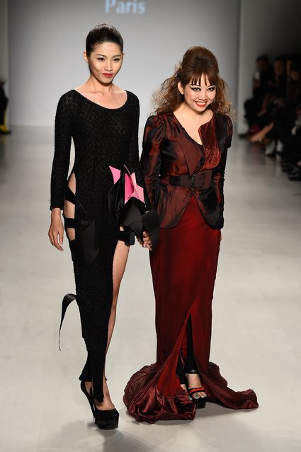 Designer Quynh Nhu Nguyen (R) walks the runway at the Charity Water fashion show during Mercedes-Benz Fashion Week Fall 2015 at The Salon at Lincoln Center on February 12, 2015 in New York City. (Photo by Frazer Harrison/Getty Images for Mercedes-Benz Fashion Week)