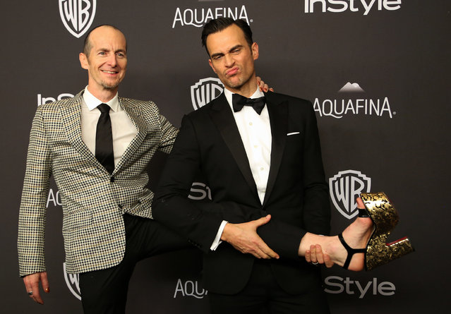 Actors Denis O'Hare (L) and Cheyenne Jackson attend the 17th Annual Instyle and Warner Bros. Pictures Golden Globes After Party in Beverly Hills, California January 10, 2016. (Photo by David McNew/Reuters)