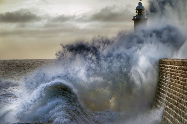 Waves break against the pier at Tynemouth, on the North East coast, England on March 30, 2020. (Photo by Owen Humphreys/PA Images via Getty Images)