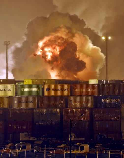 Fire rises from chemical containers from logistic company Localfrio in Guaruja, Brazil, January 14, 2016. Up to a dozen containers carrying chemicals caught fire at a terminal at Brazil's largest port of Santos on Thursday, restricting ship movement, representatives of the port authority Codesp said. (Photo by Paulo Whitaker/Reuters)