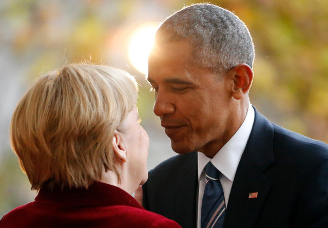 President Barack Obama is welcomed by German Chancellor Angela Merkel upon his arrival at the chancellery in Berlin, Germany, November 17, 2016. (Photo by Fabrizio Bensch/Reuters)