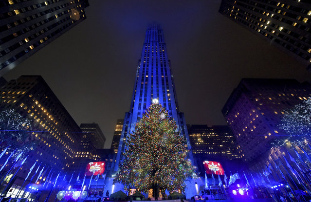 The Rockefeller Center Christmas Tree stands lit, Wednesday, November 30, 2016, in New York. The 94-foot tall Norway spruce is covered with more than 50,000 multi-colored LED lights. (Photo by Diane Bondareff/Invision for Tishman Speyer/AP Images)